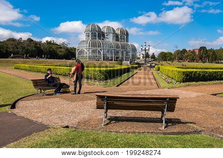 Curitiba, Brazil - July 20, 2017: People visit famous Botanical Garden of Curitiba, Brazil. The garden was opened in 1991 and covers 240.000 m2 in area.