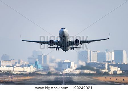Airplane taking off from the Itami International Airport in Osaka, Japan.