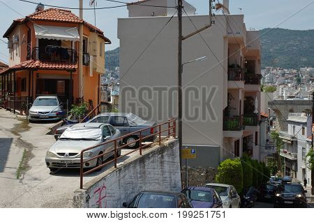 Kavala Greece - June 16 2017: city in the northern Greece in the Macedonia-Thrace region located on the Aegean Sea. The road leading to the Byzantine citadel located on the hill. Along the way there are residential buildings.