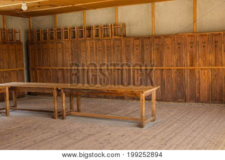 Dachau Concentration Camp Germany - July 30 2016: Wooden lockers from barrack room showing terrible prisoners living conditions from extermination camp.