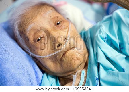 RatchabureeThailand 6 August 2017 old grand mother healing healthy with oxygen line in hospital show aging of life