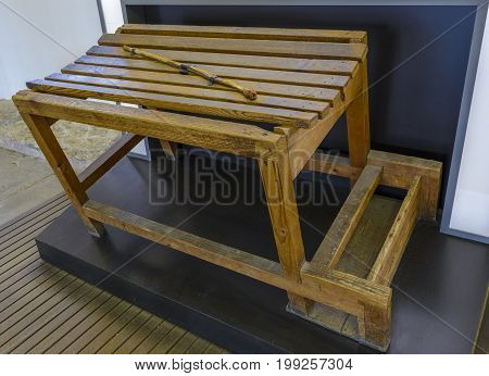 Dachau Concentration Camp Germany - August 29 2015: Bull whip trestle on the punishment table showing terrible prisoners living conditions from extermination camp.
