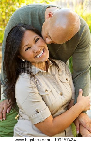 Cute happy Asian couple laughing and smiling.