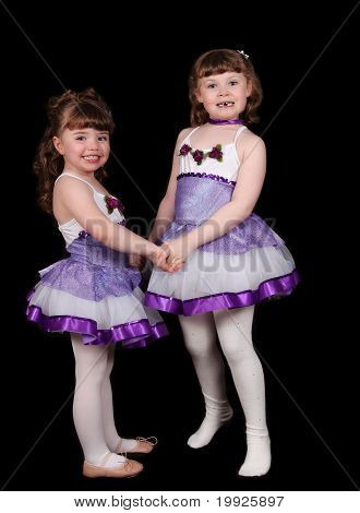 Adorable Little Ballet Dancers Holding Hands. Isolated