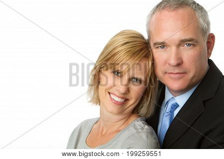 Well dressed mature couple isolated on white.