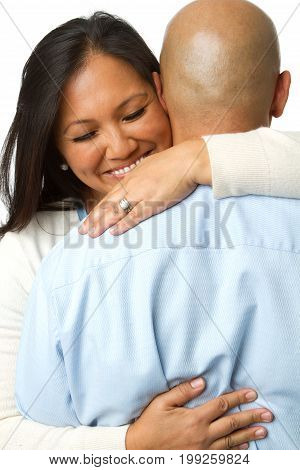 Rear view of a woman hugging her husband isolated on white.