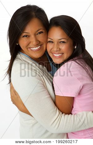Asian mother and daughter isolated on white.