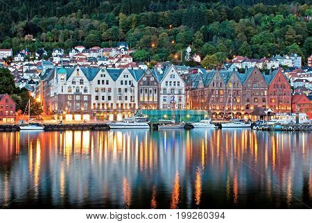 View Of Bergen At Night Time With Colorful Building And Reflection.