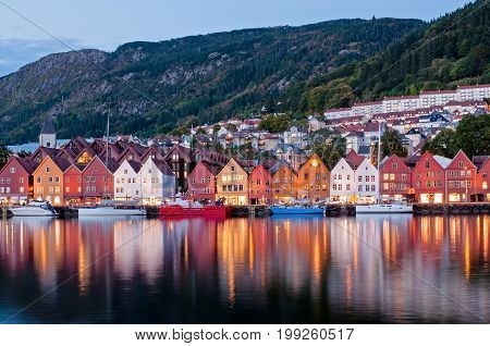 Night View Of Bryggen With Colorful Light And Reflection, Also Known As Tyskebryggen, Is A Series Of