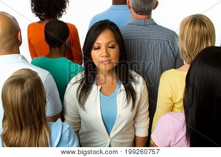 Asian woman feeling alone in a crowd.