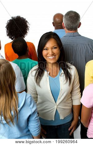 Woman standing in a crowd isolated on white.