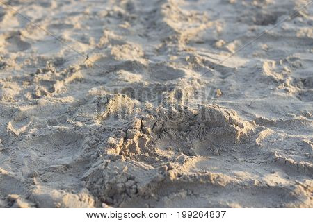 Sand on beach by ocean in summer on holiday.