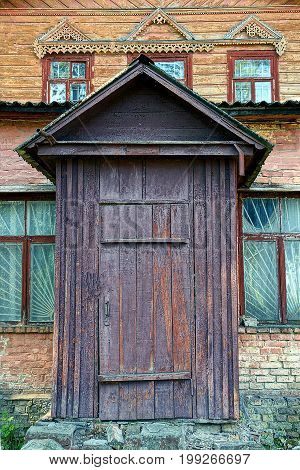 Wooden brown door on the old house