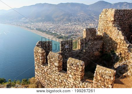View of the city and Cleopatra Beach from the observation platform of Alanya Castle (Alanya, Turkey).