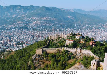 View of Alanya Castle and the city from the highest point of the terrain (Alanya, Turkey).