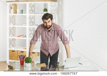 Smiling Man Leaning On Office Table