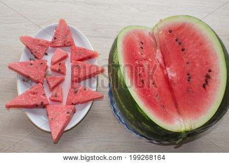 Organic Ripe Seedless Watermelon Cut into Wedges. Triangle shaped watermelon slices