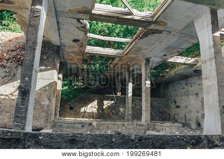 View down in the old destroyed abandoned factory building, shaft, floors without overlap
