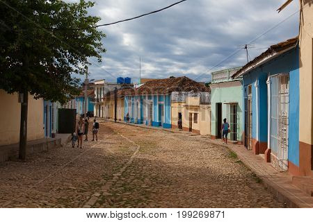 Trinidad Cuba - January 30 2017: Typical colonial street in Trinidad.One of UNESCOs World Heritage sites since 1988. Due to embargo Cuba had problem with plenty of building material.