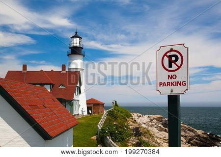 Cape Elizabeth Maine USA: July 6 2016: Portland Head Light (lighthouse) in Cape Elizabeth (Portland suburb) Maine. Situated along the spectacular shores of Fort Williams Park