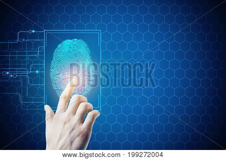 Hand pressing abstract digital finger print button on blue background with cells and copy space. Biometrics safety and access concept