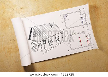 White paper roll with house drawing placed on light wooden background. Architecture and engineering concept. 3D Rendering