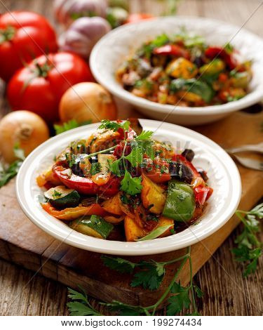 Ratatouille, Vegetarian stew made of zucchini, eggplants, peppers, onions, garlic and tomatoes with aromatic herbs. Traditional french food