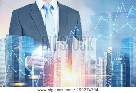 Businessman Pointing At Graphs In A City
