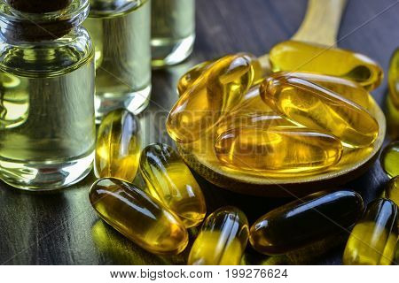 A bottle of omega 3 fish oil capsules or linseed oil