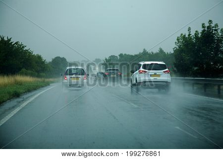 5th August 2017, A12 Colchester, Essex, England, Cars driving fast on a major road in torrential rain.