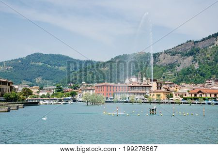 LAKE ISEO, ITALY. 3rd August 2017. View of the charming little town of Sarnico and the iron bridge that links it to its neighbour, Paratico.