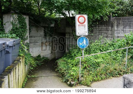 scary underpass with street sign and dark entrance