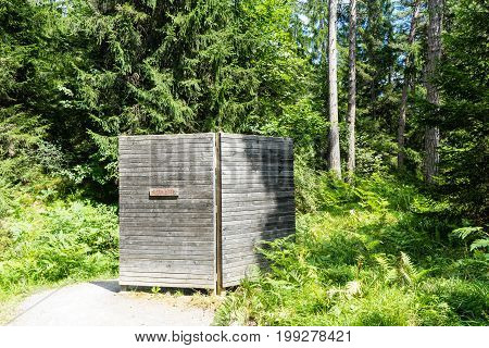 public toilet in forest for hikers in flims switzerland