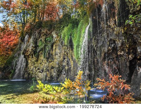 Waterfall in autumn forest at National Park Plitvice Lakes. Croatia.