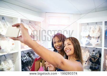 Two Happy Young Women Posing In A Fashion Store