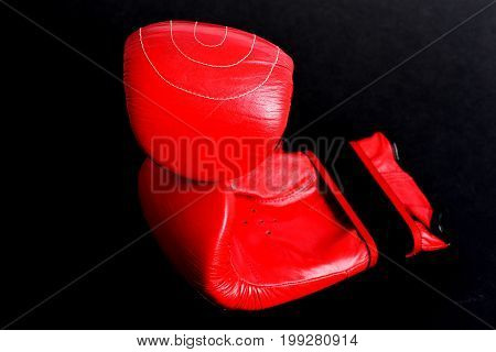 Red Leather Gloves For Thai Boxing Isolated On Black Background