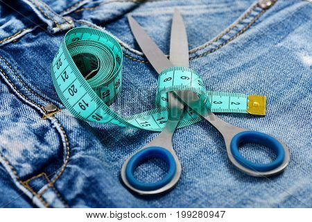 Making Clothes And Design Concept: Tailors Tools On Denim Pants