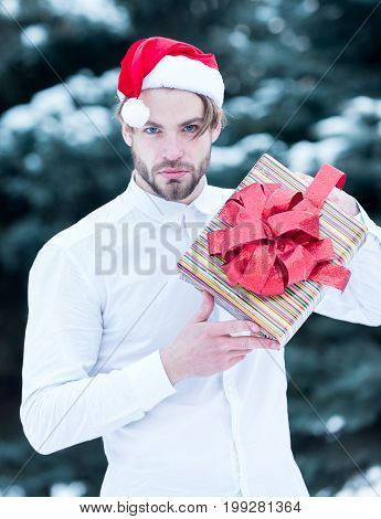 Handsome Santa Man With Present Box In Winter Outdoor