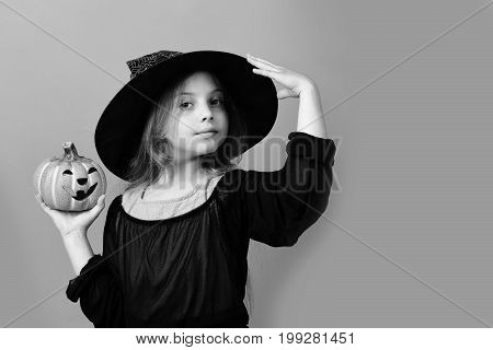 Kid In Black Witch Hat, Dress And Smiling Face
