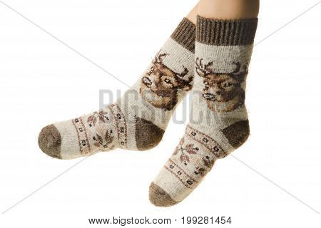 Knitted socks on female legs on a white background isolation