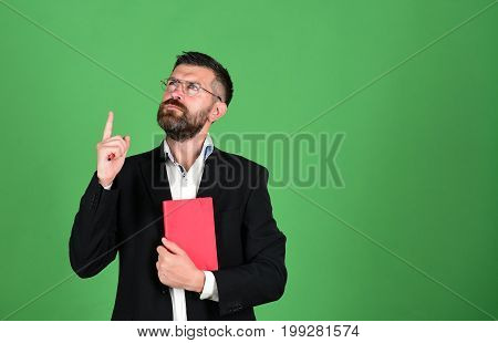 Teacher Wears Glasses, Holds Organizer. Man With Beard And Book
