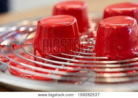 cooking, confectionery and food concept - mirror glaze cakes at pastry shop