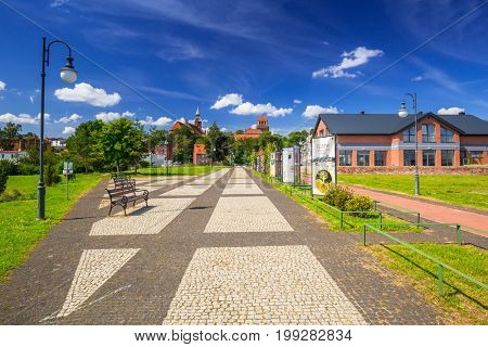 TCZEW, POLAND - AUGUST 8, 2017: Promenade in the park on riverbanks of Vistula river in Tczew, Poland. Tczew is a town at Vistula River in northern Poland.