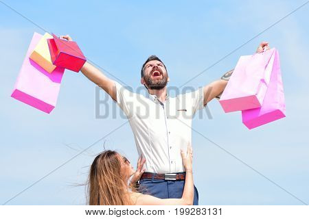 Man With Beard And Pretty Woman Hold Shopping Bags