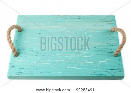 Wooden chopping board painted with turquoise paint isolated on white