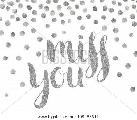 Handwritten calligraphic silver textured inscription Miss you on white background with silver dots. Lettering for postcard, Valentine day card, greeting, save the date card. Vector illustration.