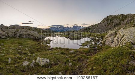 Sunrise above mountain lake. Laghi di Cornisello, Brenta group in Italy.