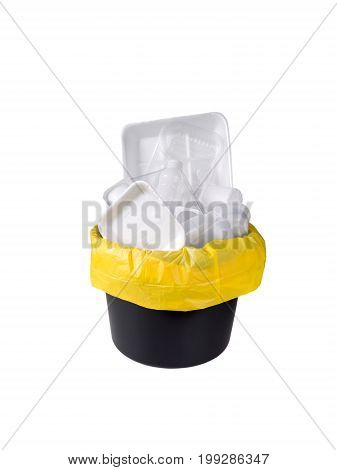 Separate garbage collection. Plastic pack waste in the black bucket and yellow plastic bag isolated on white.