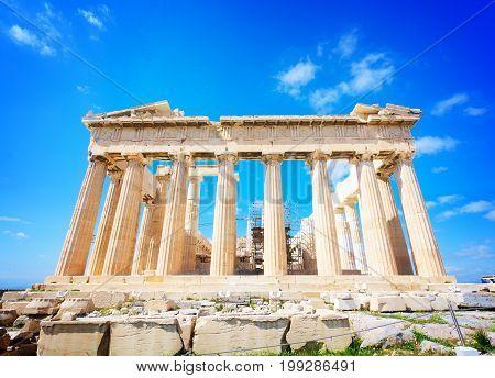 facade of Parthenon temple over bright blue sky background, Acropolis hill, Athens Greece, retro toned