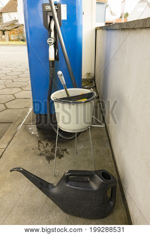 White bucket with water on gas station